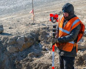 freezer clothing – a man, dressed in winter workwear, working outdoors in extreme cold weather.