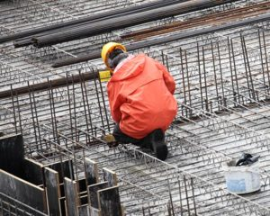 rainwear – a construction worker on site, dressed in a rain jacket and hard hat.